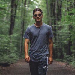 Man walking in woods.